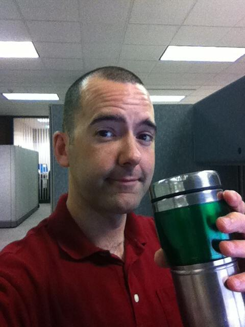 Brian with coffee at the office.