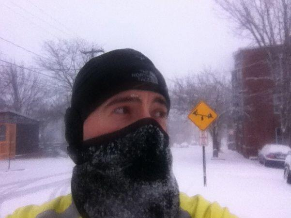 Brian with his face covered after a snow storm